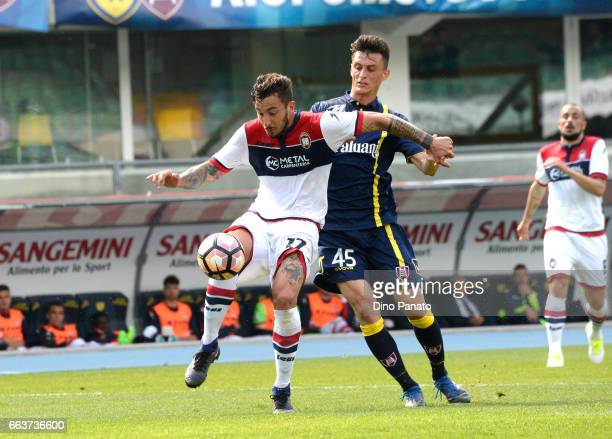 Roberto Inglese of ChievoVerona competes with Federico Ceccherini of Crotone during the Serie A match between AC ChievoVerona and FC Crotone at...