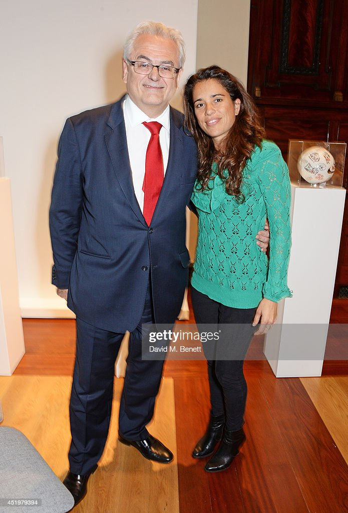 Roberto Jaguaribe (L), Ambassador of Brazil to the United Kingdom, and Jimena Paratcha, Founding Trustee of ABC TRUST, attend 'The Art Of Futebol' charity auction in support of Action for Brazil's Children Trust at the Embassy of Brazil on July 10, 2014 in London, England.