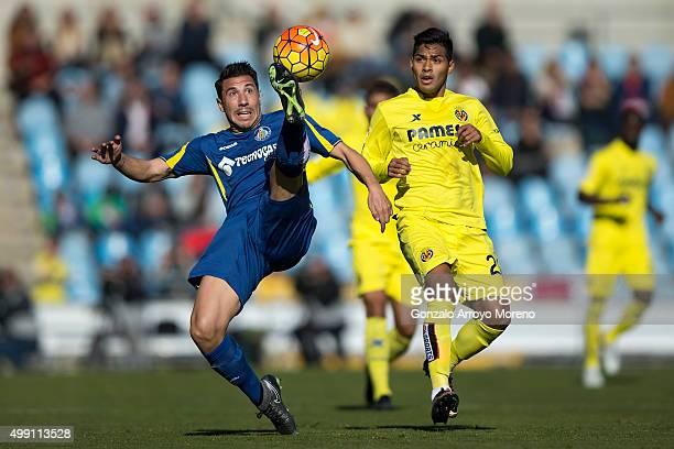 Roberto Lago of Getafe CF competes for the ball with Matias Nahuel of Villarreal CF during the La Liga match between Getafe CF and Villareal CF at...