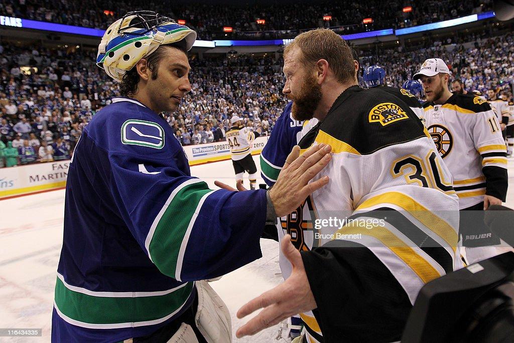 Roberto Luongo of the Vancouver Canucks congratulates Tim Thomas of the Boston Bruins after defeating the Vancouver Canucks in Game Seven of the 2011...