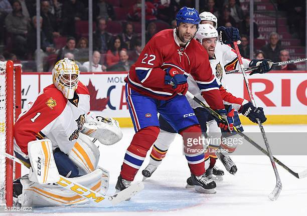 Roberto Luongo and Aaron Ekblad of the Florida Panthers protect the net against John Scott of the Montreal Canadiens in the NHL game at the Bell...