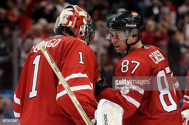 Roberto Luongo of Canada celebrates with Sidney Crosby after defeating Germany during the ice hockey Men's Qualification Playoff game between Germany...