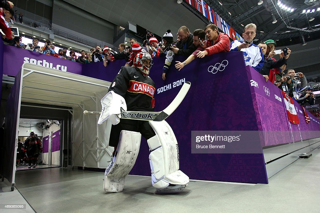 Roberto Luongo #1 of Canada high fives fans prior to the Men's Ice Hockey Preliminary Round Group B game against Austria on day seven of the Sochi 2014 Winter Olympics at Bolshoy Ice Dome on February 14, 2014 in Sochi, Russia.
