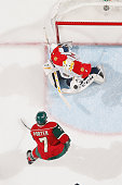 Roberto Luongo of the Florida Panthers makes a save against Chris Porter of the Minnesota Wild during the game on February 28 2016 at the Xcel Energy...