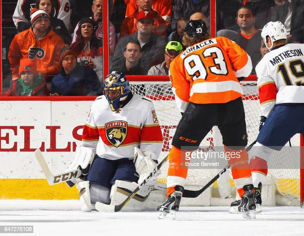 Roberto Luongo of the Florida Panthers makes the first period save as Jakub Voracek of the Philadelphia Flyers looks for a rebound at the Wells Fargo...
