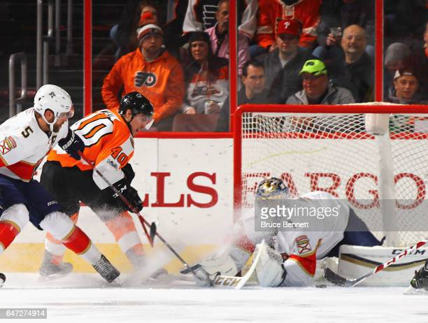Roberto Luongo of the Florida Panthers makes the first period save on Jordan Weal of the Philadelphia Flyers at the Wells Fargo Center on March 2...