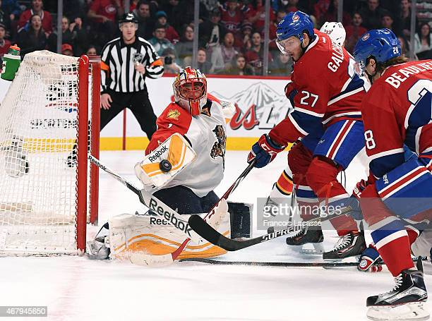 Roberto Luongo of the Florida Panthers stops a shot by Alex Galchenyuk of the Montreal Canadiens in the NHL game at the Bell Centre on March 28 2015...