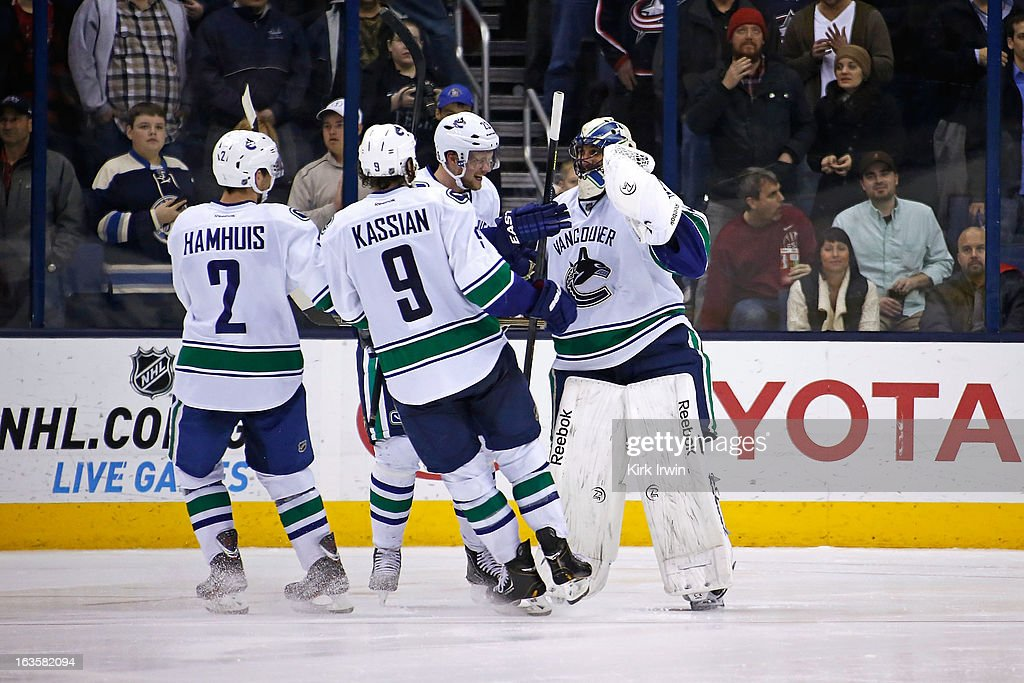 <a gi-track='captionPersonalityLinkClicked' href=/galleries/search?phrase=Roberto+Luongo&family=editorial&specificpeople=202638 ng-click='$event.stopPropagation()'>Roberto Luongo</a> #1 of the Vancouver Canucks is congratulated by his teammates after defeating the Columbus Blue Jackets 2-1 in a shootout on March 12, 2013 at Nationwide Arena in Columbus, Ohio.