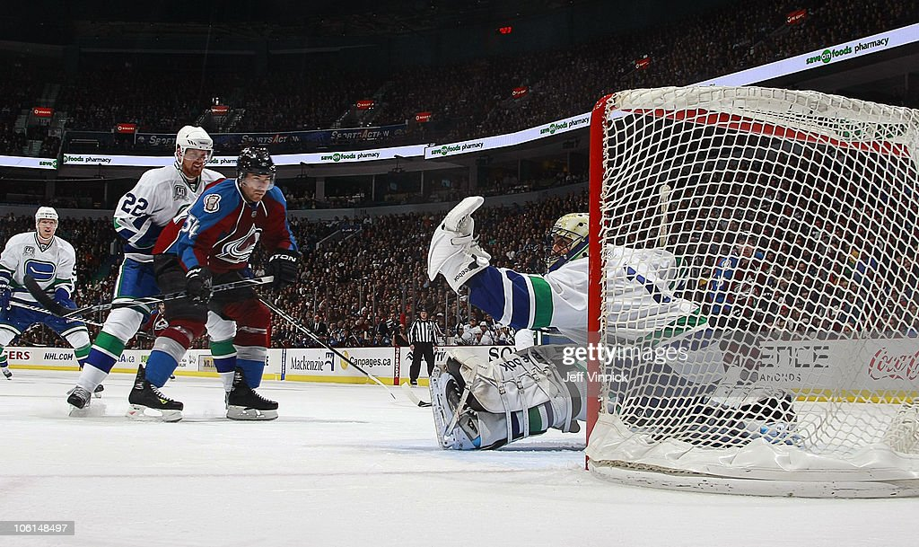 <a gi-track='captionPersonalityLinkClicked' href=/galleries/search?phrase=Roberto+Luongo&family=editorial&specificpeople=202638 ng-click='$event.stopPropagation()'>Roberto Luongo</a> #1 of the Vancouver Canucks makes a big save on David Jones #54 of the Colorado Avalanche while <a gi-track='captionPersonalityLinkClicked' href=/galleries/search?phrase=Daniel+Sedin&family=editorial&specificpeople=202492 ng-click='$event.stopPropagation()'>Daniel Sedin</a> #22 of the Vancouver Canucks looks on at Rogers Arena on October 26, 2010 in Vancouver, British Columbia, Canada.