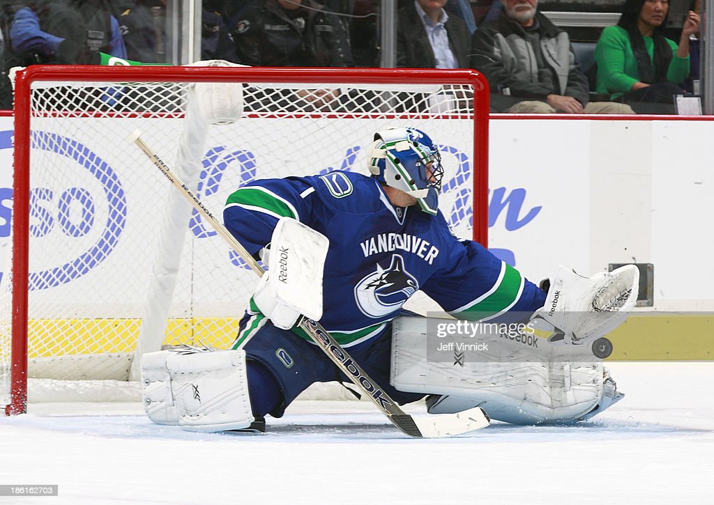 <a gi-track='captionPersonalityLinkClicked' href=/galleries/search?phrase=Roberto+Luongo&family=editorial&specificpeople=202638 ng-click='$event.stopPropagation()'>Roberto Luongo</a> #1 of the Vancouver Canucks makes a save against the Washington Capitals during their NHL game at Rogers Arena on October 28, 2013 in Vancouver, British Columbia, Canada.