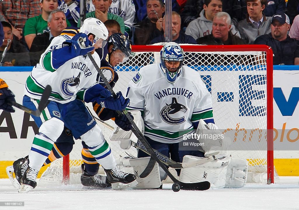 <a gi-track='captionPersonalityLinkClicked' href=/galleries/search?phrase=Roberto+Luongo&family=editorial&specificpeople=202638 ng-click='$event.stopPropagation()'>Roberto Luongo</a> #1 of the Vancouver Canucks makes a save as teammate <a gi-track='captionPersonalityLinkClicked' href=/galleries/search?phrase=Ryan+Stanton&family=editorial&specificpeople=7184071 ng-click='$event.stopPropagation()'>Ryan Stanton</a> #18 ties up <a gi-track='captionPersonalityLinkClicked' href=/galleries/search?phrase=Tyler+Ennis+-+Ice+Hockey+Player&family=editorial&specificpeople=4754184 ng-click='$event.stopPropagation()'>Tyler Ennis</a> #63 of the Buffalo Sabres on October 17, 2013 at the First Niagara Center in Buffalo, New York. Vancouver won, 3-0.