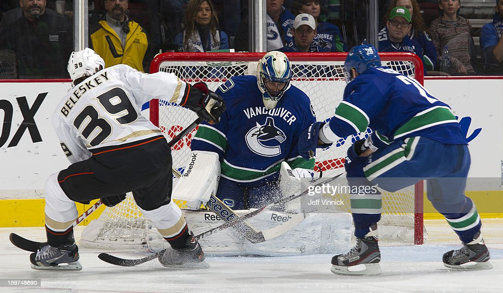 <a gi-track='captionPersonalityLinkClicked' href=/galleries/search?phrase=Roberto+Luongo&family=editorial&specificpeople=202638 ng-click='$event.stopPropagation()'>Roberto Luongo</a> #1 of the Vancouver Canucks makes a save on <a gi-track='captionPersonalityLinkClicked' href=/galleries/search?phrase=Matt+Beleskey&family=editorial&specificpeople=570471 ng-click='$event.stopPropagation()'>Matt Beleskey</a> #39 of the Anaheim Ducks while Chris Higgins #20 of the Canucks backchecks in the season-opening NHL game at Rogers Arena January 19, 2013 in Vancouver, British Columbia, Canada. Anaheim won 7-3.