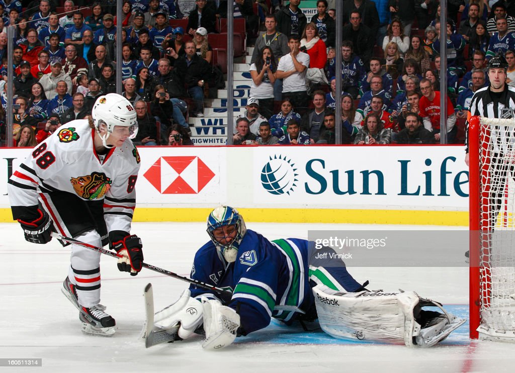 <a gi-track='captionPersonalityLinkClicked' href=/galleries/search?phrase=Roberto+Luongo&family=editorial&specificpeople=202638 ng-click='$event.stopPropagation()'>Roberto Luongo</a> #1 of the Vancouver Canucks makes a shootout save on Patrick Kane #88 of the Chicago Blackhawks during their NHL game at Rogers Arena February 1, 2013 in Vancouver, British Columbia, Canada. Vancouver won 2-1 in a shootout.