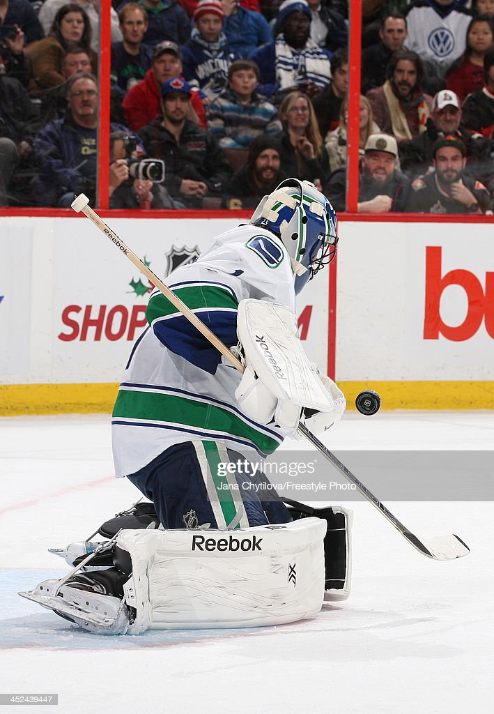 <a gi-track='captionPersonalityLinkClicked' href=/galleries/search?phrase=Roberto+Luongo&family=editorial&specificpeople=202638 ng-click='$event.stopPropagation()'>Roberto Luongo</a> #1 of the Vancouver Canucks makes one of thirty-seven saves during an NHL game against the Ottawa Senators at Canadian Tire Centre on November 28, 2013 in Ottawa, Ontario, Canada.