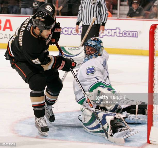Roberto Luongo of the Vancouver Canucks saves a shot on goal during the shoot out against Steve Montador of the Anaheim Ducks during the game on...