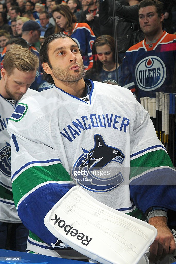 <a gi-track='captionPersonalityLinkClicked' href=/galleries/search?phrase=Roberto+Luongo&family=editorial&specificpeople=202638 ng-click='$event.stopPropagation()'>Roberto Luongo</a> #1 of the Vancouver Canucks stands for the singing of the national anthem prior to a game against the Edmonton Oilers on March 30, 2013 at Rexall Place in Edmonton, Alberta, Canada.