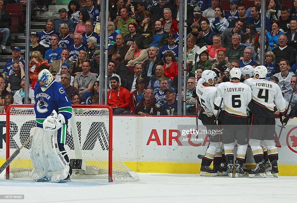 <a gi-track='captionPersonalityLinkClicked' href=/galleries/search?phrase=Roberto+Luongo&family=editorial&specificpeople=202638 ng-click='$event.stopPropagation()'>Roberto Luongo</a> #1 of the Vancouver Canucks turns away while Anaheim Ducks celebrate a goal during their NHL game at Rogers Arena April 25, 2013 in Vancouver, British Columbia, Canada. Anaheim won 3-1.
