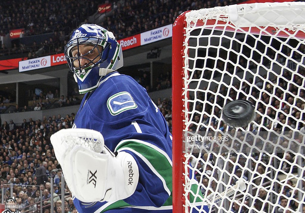 <a gi-track='captionPersonalityLinkClicked' href=/galleries/search?phrase=Roberto+Luongo&family=editorial&specificpeople=202638 ng-click='$event.stopPropagation()'>Roberto Luongo</a> #1 of the Vancouver Canucks watches a Washington Capitals shot go wide during their NHL game at Rogers Arena on October 28, 2013 in Vancouver, British Columbia, Canada. Vancouver won 3-2.