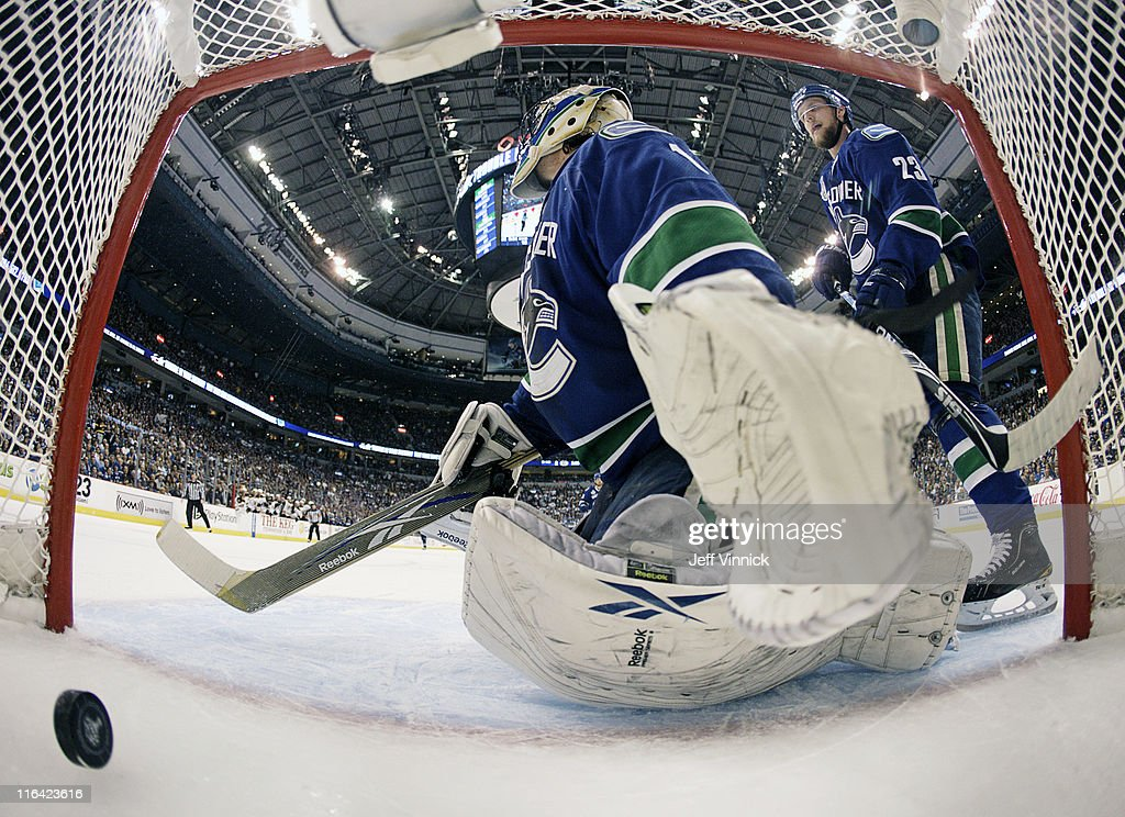 <a gi-track='captionPersonalityLinkClicked' href=/galleries/search?phrase=Roberto+Luongo&family=editorial&specificpeople=202638 ng-click='$event.stopPropagation()'>Roberto Luongo</a> #1 reacts to a Boston Bruins goal during Game Seven of 2011 NHL Stanley Cup Final between the Boston Bruins and the Vancouver Canucks at Rogers Arena on June 15, 2011 in Vancouver, British Columbia, Canada.