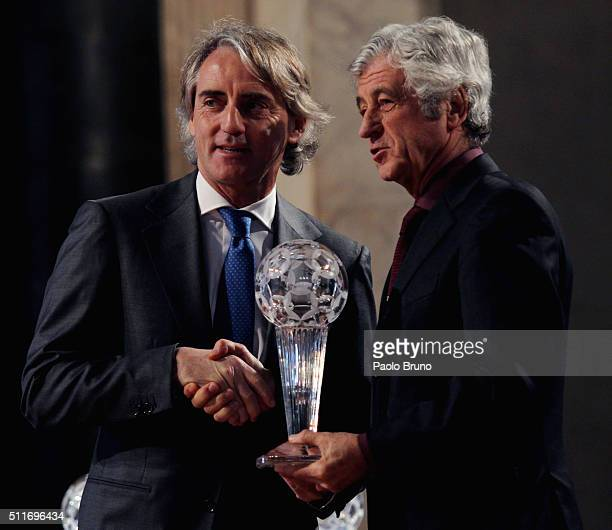 Roberto Mancini and Gianni Rivera pose showing the award during the Italian Football Federation Hall of Fame Award ceremony at Palazzo Vecchio on...