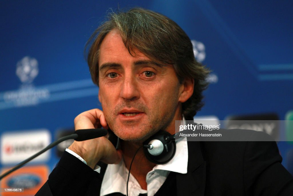 <a gi-track='captionPersonalityLinkClicked' href=/galleries/search?phrase=Roberto+Mancini&family=editorial&specificpeople=234429 ng-click='$event.stopPropagation()'>Roberto Mancini</a>, head coach of Manchester City talks to the media during a press conference ahead of the UEFA Champions League group A first leg match against Bayern Muenchen at Allianz Arena on September 26, 2011 in Munich, Germany.