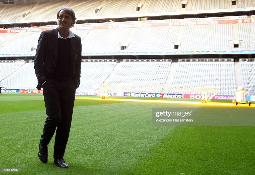 Roberto Mancini, head coach of Manchester City walks over the field prior to a press conference ahead of the UEFA Champions League group A first leg match against Bayern Muenchen at Allianz Arena on September 26, 2011 in Munich, Germany.