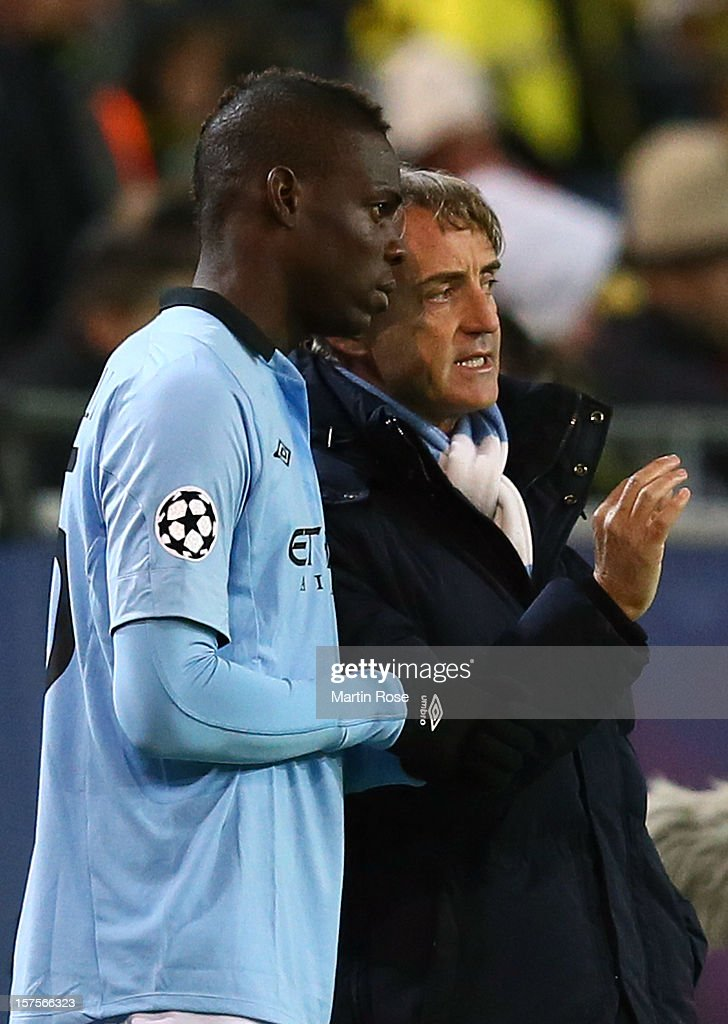 <a gi-track='captionPersonalityLinkClicked' href=/galleries/search?phrase=Roberto+Mancini&family=editorial&specificpeople=234429 ng-click='$event.stopPropagation()'>Roberto Mancini</a>, head coach of Manchester speaks to <a gi-track='captionPersonalityLinkClicked' href=/galleries/search?phrase=Mario+Balotelli&family=editorial&specificpeople=4940446 ng-click='$event.stopPropagation()'>Mario Balotelli</a> (L) during the UEFA Champions League group D match between Borussia Dortmund and Manchester City at Signal Iduna Park on December 4, 2012 in Dortmund, Germany.