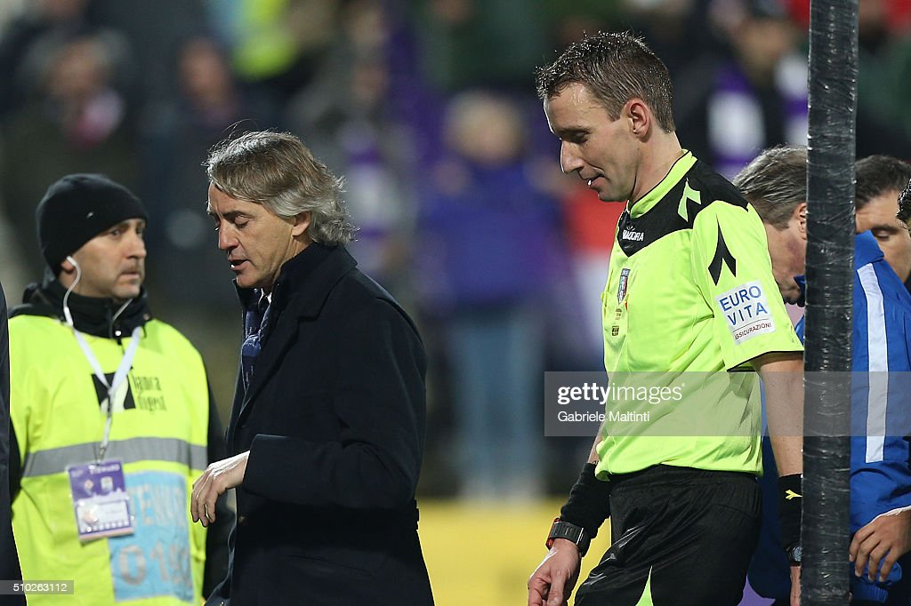 <a gi-track='captionPersonalityLinkClicked' href=/galleries/search?phrase=Roberto+Mancini&family=editorial&specificpeople=234429 ng-click='$event.stopPropagation()'>Roberto Mancini</a> manager of FC Internazionale Milano speaks with Silvio Mazzoleni referee during the Serie A match between ACF Fiorentina and FC Internazionale Milano at Stadio Artemio Franchi on February 14, 2016 in Florence, Italy.