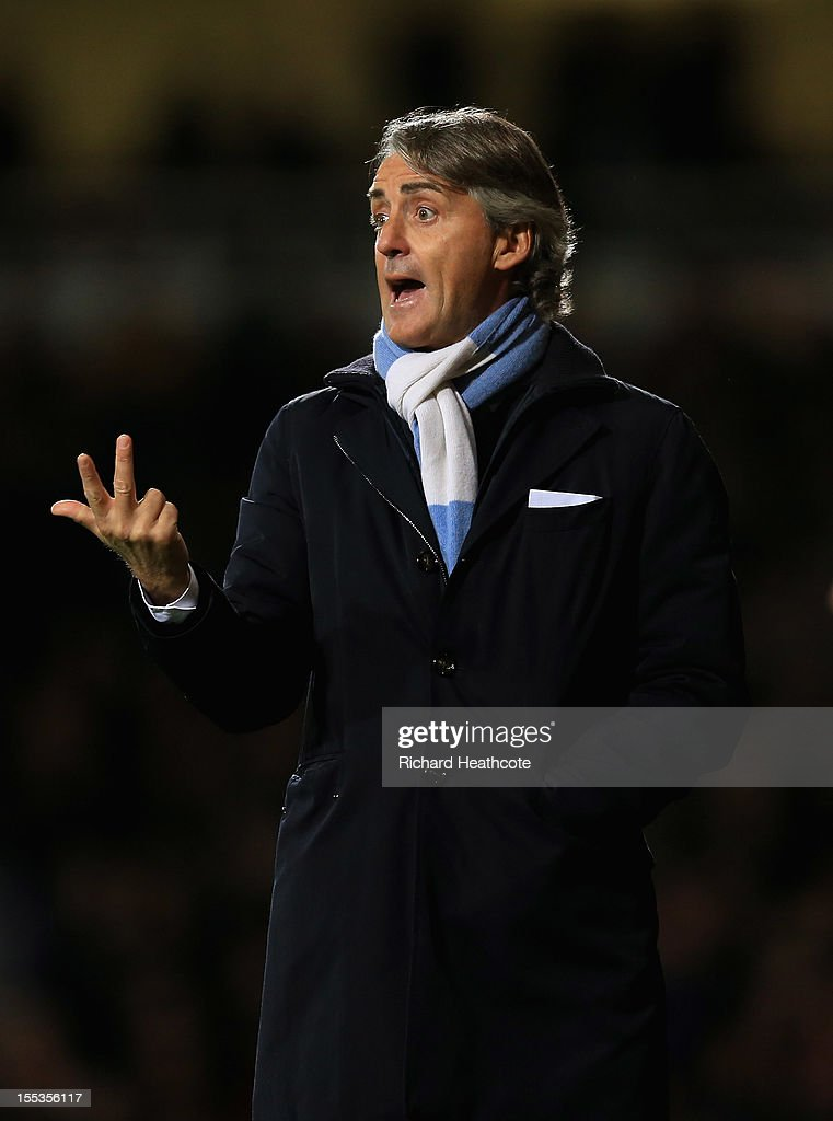<a gi-track='captionPersonalityLinkClicked' href=/galleries/search?phrase=Roberto+Mancini&family=editorial&specificpeople=234429 ng-click='$event.stopPropagation()'>Roberto Mancini</a>, manager of Manchester City gives instructions during the Barclays Premier League match between West Ham United and Manchester City at the Boleyn Ground on November 3, 2012 in London, England.