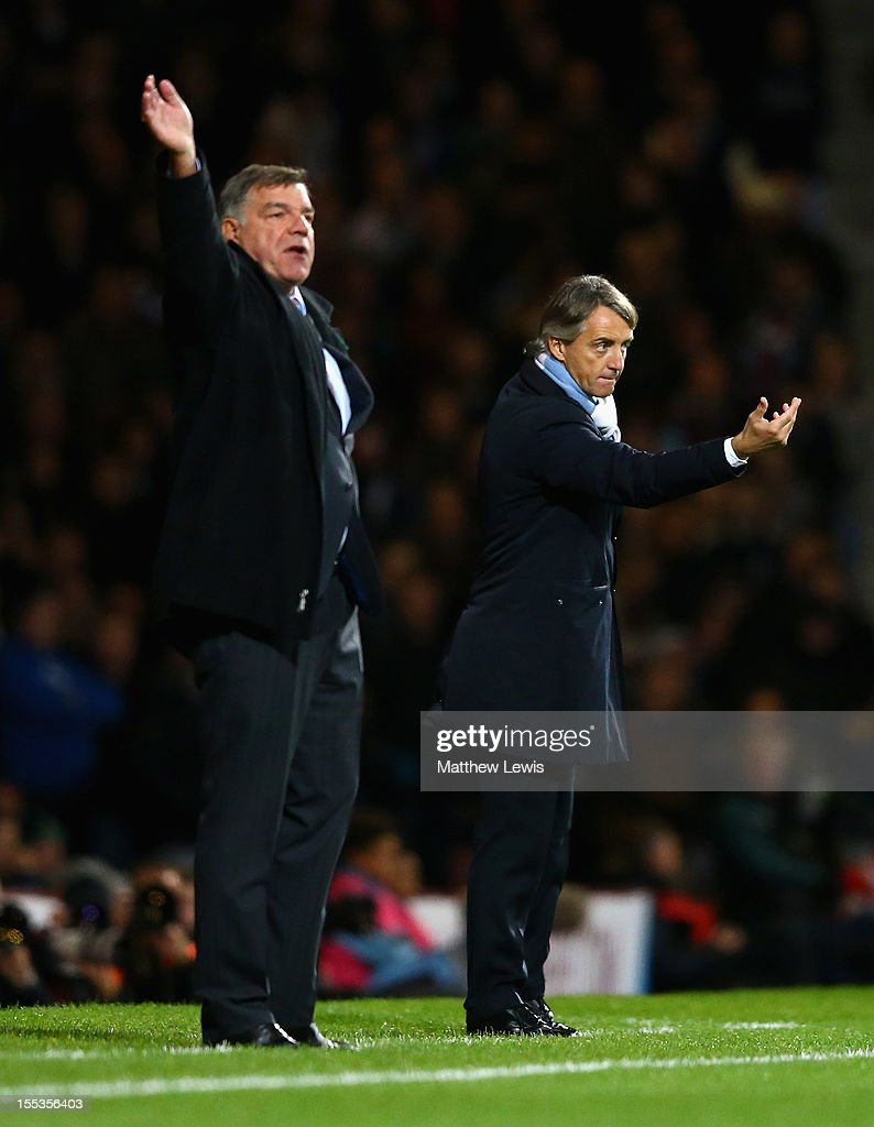 <a gi-track='captionPersonalityLinkClicked' href=/galleries/search?phrase=Roberto+Mancini&family=editorial&specificpeople=234429 ng-click='$event.stopPropagation()'>Roberto Mancini</a> (R), manager of Manchester City gives instructions with <a gi-track='captionPersonalityLinkClicked' href=/galleries/search?phrase=Sam+Allardyce&family=editorial&specificpeople=214691 ng-click='$event.stopPropagation()'>Sam Allardyce</a>, manager of West Ham United during the Barclays Premier League match between West Ham United and Manchester City at the Boleyn Ground on November 3, 2012 in London, England.