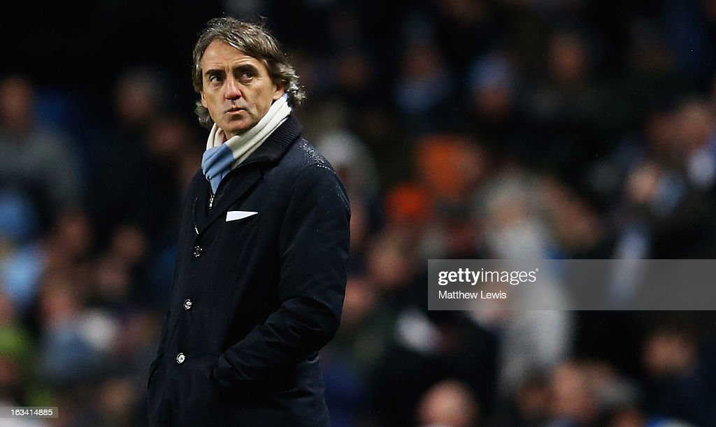 Roberto Mancini, manager of Manchester City looks on during the FA Cup sponsored by Budweiser Sixth Round match between Manchester City and Barnsley at Etihad Stadium on March 9, 2013 in Manchester, England.