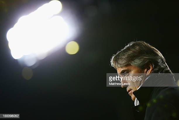 Roberto Mancini manager of Manchester City looks on prior to the Barclays Premier League match between West Ham United and Manchester City at the...