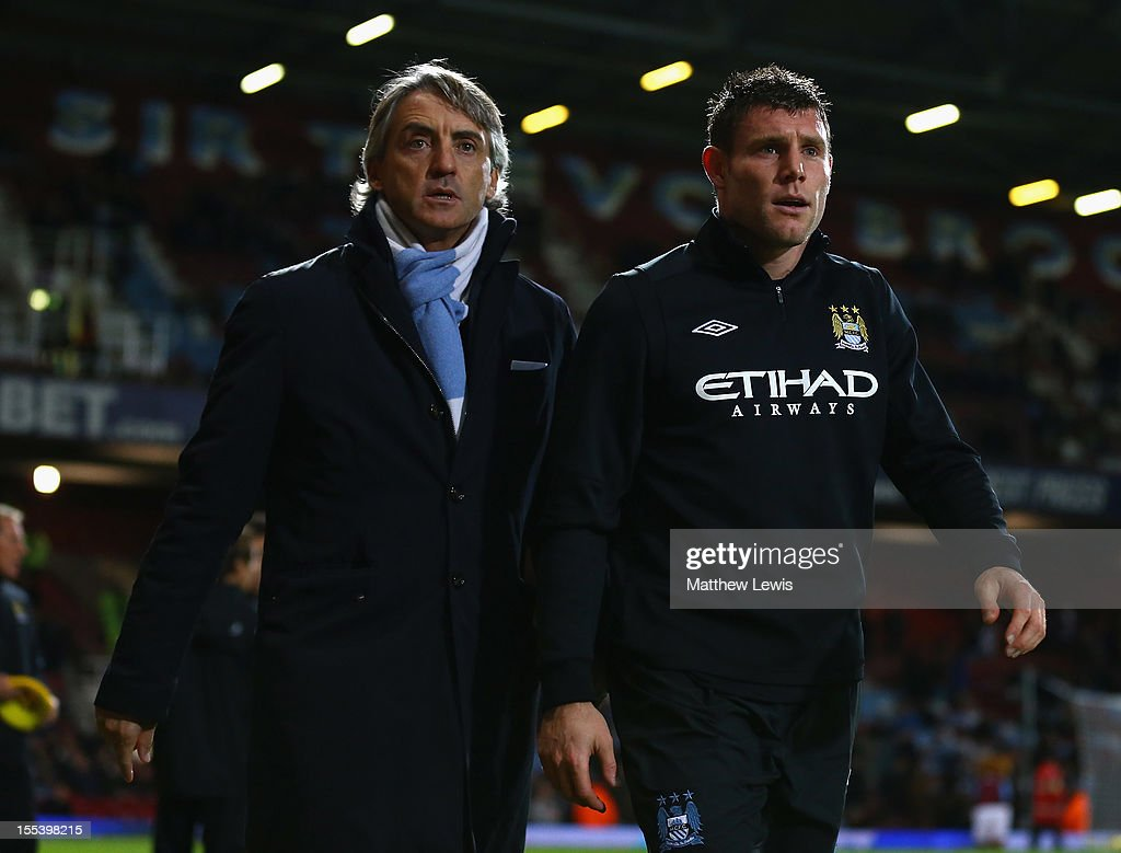 <a gi-track='captionPersonalityLinkClicked' href=/galleries/search?phrase=Roberto+Mancini&family=editorial&specificpeople=234429 ng-click='$event.stopPropagation()'>Roberto Mancini</a>, manager of Manchester City walks with <a gi-track='captionPersonalityLinkClicked' href=/galleries/search?phrase=James+Milner+-+Soccer+Player&family=editorial&specificpeople=214576 ng-click='$event.stopPropagation()'>James Milner</a> prior to the Barclays Premier League match between West Ham United and Manchester City at the Boleyn Ground on November 3, 2012 in London, England.