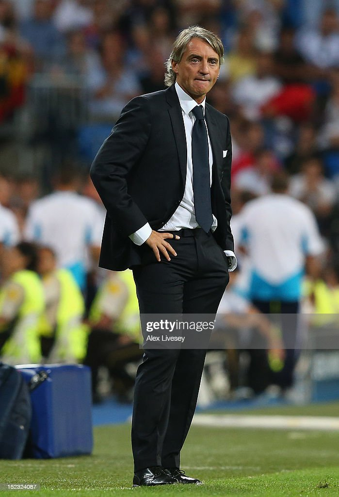 <a gi-track='captionPersonalityLinkClicked' href=/galleries/search?phrase=Roberto+Mancini&family=editorial&specificpeople=234429 ng-click='$event.stopPropagation()'>Roberto Mancini</a> the manager of Manchester City FC looks on during the UEFA Champions League Group D match between Real Madrid and Manchester City FC at Estadio Santiago Bernabeu on September 18, 2012 in Madrid, Spain.