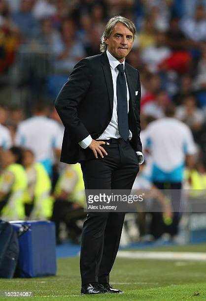 Roberto Mancini the manager of Manchester City FC looks on during the UEFA Champions League Group D match between Real Madrid and Manchester City FC...
