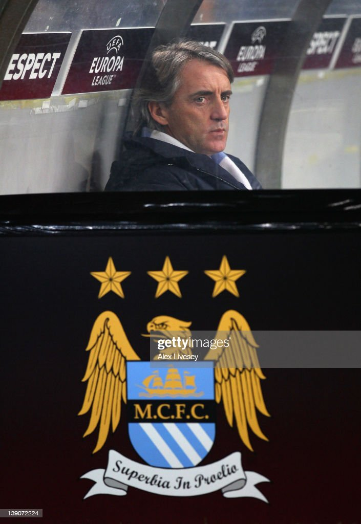 <a gi-track='captionPersonalityLinkClicked' href=/galleries/search?phrase=Roberto+Mancini&family=editorial&specificpeople=234429 ng-click='$event.stopPropagation()'>Roberto Mancini</a> the manager of Manchester City looks on prior to the UEFA Europa League round of 32 first leg match between FC Porto and Manchester City at Estadio do Dragao on February 16, 2012 in Porto, Portugal.
