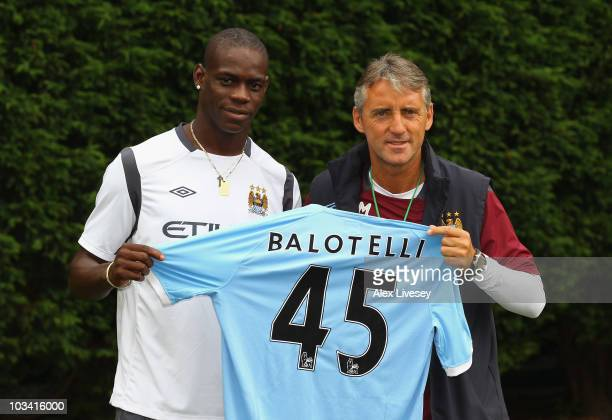 Roberto Mancini the manager of Manchester City unveils his new signing Mario Balotelli at the Carrington Training Complex on August 17 2010 in...