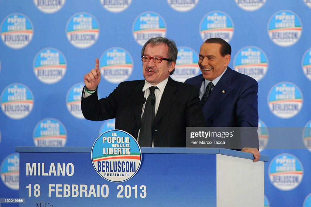 <a gi-track='captionPersonalityLinkClicked' href=/galleries/search?phrase=Roberto+Maroni&family=editorial&specificpeople=665299 ng-click='$event.stopPropagation()'>Roberto Maroni</a>, Northern League Party Secretary and candidate for governor of the Lombardy region in the next regional elections, speaks with former Italian Prime Minister <a gi-track='captionPersonalityLinkClicked' href=/galleries/search?phrase=Silvio+Berlusconi&family=editorial&specificpeople=201842 ng-click='$event.stopPropagation()'>Silvio Berlusconi</a> during a political rally on February 18, 2013 in Milan, Italy. Berlusconi is entering the last week of campaigning for his party Popolo della Liberta. Italians go to the polls February 24-25.