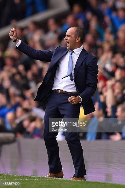 Roberto Martinez manager of Everton celebrates the second goal scored by Steven Naismith during the Barclays Premier League match between Everton and...