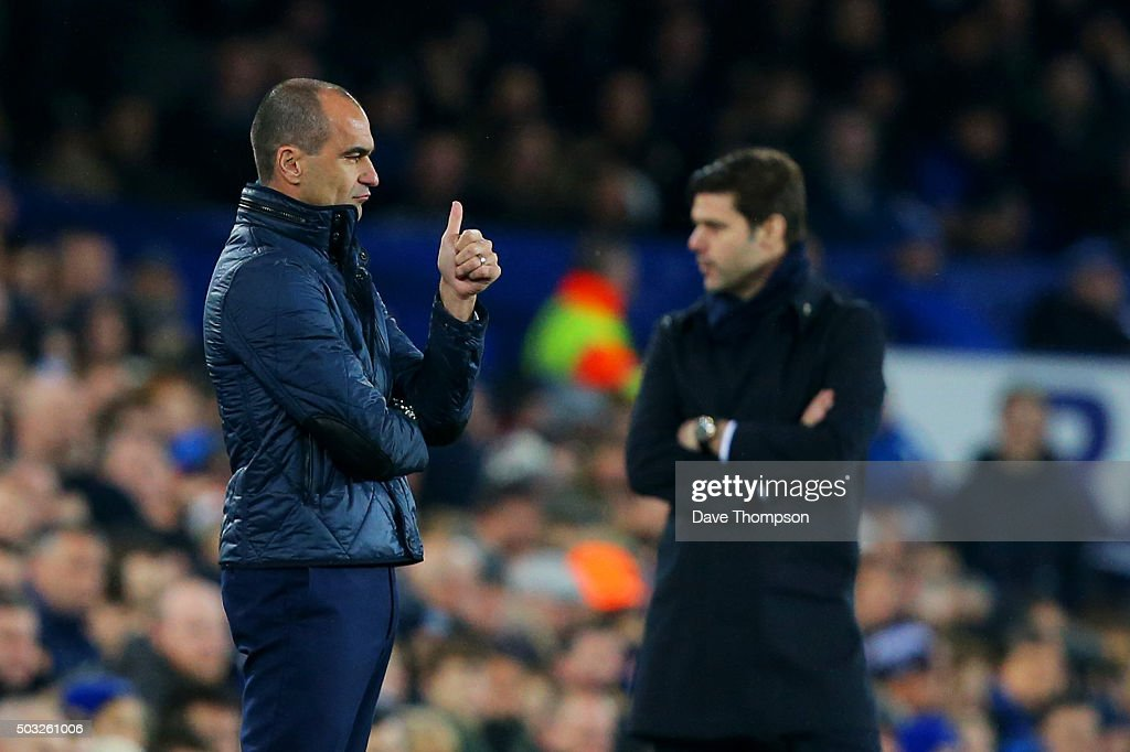 Roberto Martinez, manager of Everton gives a thumbs up to his players as Mauricio Pochettino, manager of Tottenham Hotspur looks on during the Barclays Premier League match between Everton and Tottenham Hotspur at Goodison Park on January 3, 2016 in Liverpool, England.
