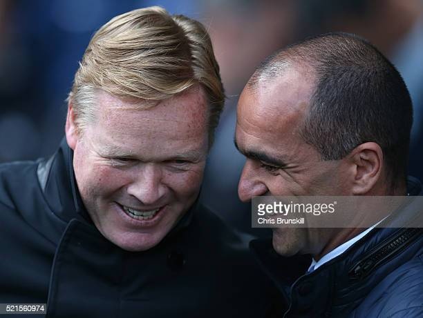 Roberto Martinez manager of Everton greets Ronald Koeman manager of Southampton during the Barclays Premier League match between Everton and...