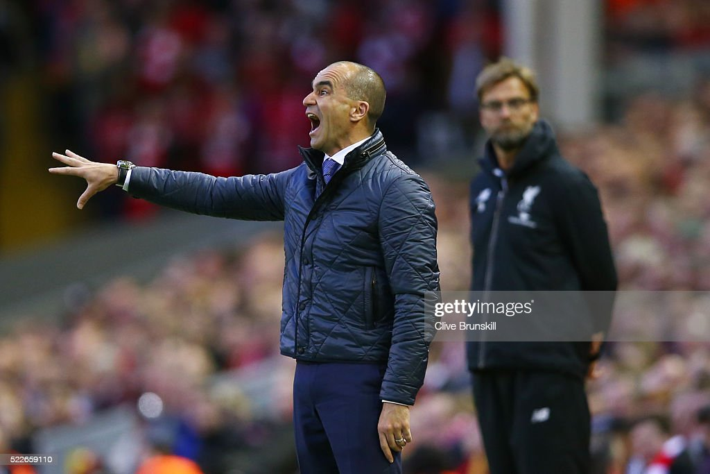 Roberto Martinez Manager of Everton reacts whilst Jurgen Klopp, manager of Liverpool looks on during the Barclays Premier League match between Liverpool and Everton at Anfield, April 20, 2016, Liverpool, England