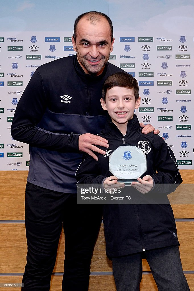 Roberto Martinez presents Everton's goal of the month award to George Shaw at Finch Farm on February 11, 2016 in Halewood, England.