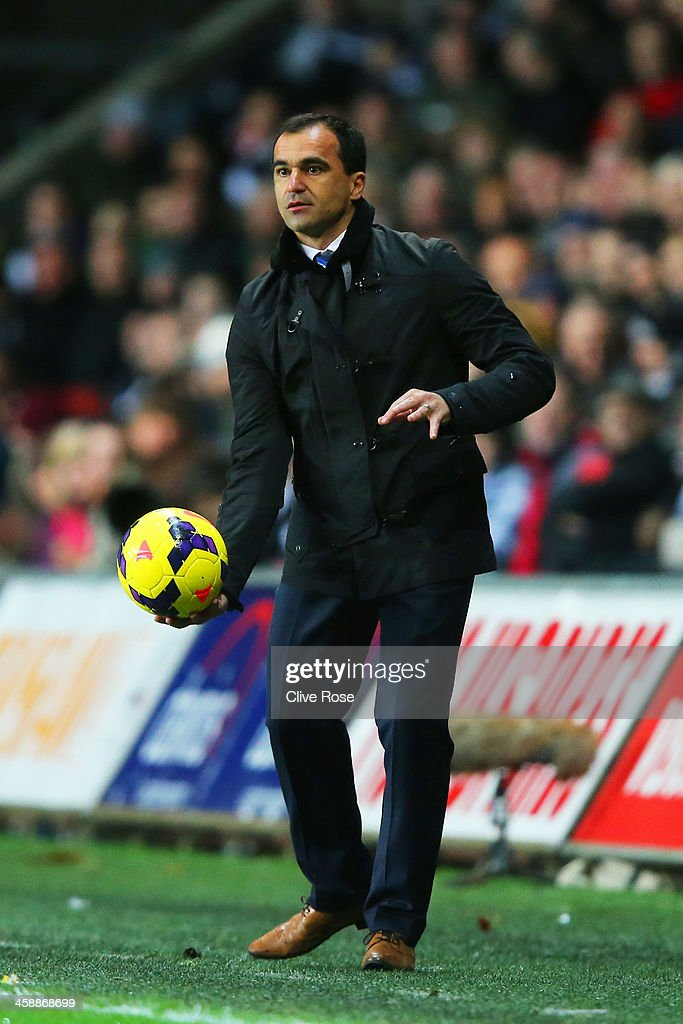 Roberto Martinez the Everton manager looks on during the Barclays Premier League match between Swansea City and Everton at the Liberty Stadium on December 22, 2013 in Swansea, Wales.