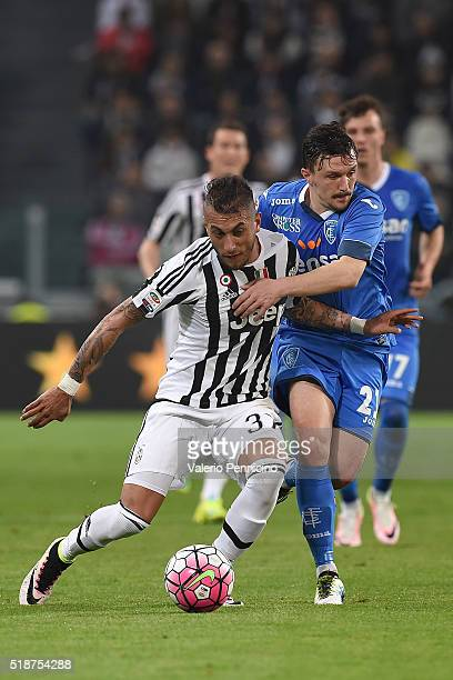 Roberto Maximilian Pereyra of Juventus FC is challenged by Mario Rui Silva Duarte of Empoli FC during the Serie A match between Juventus FC and...
