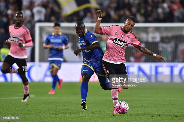 Roberto Maximilian Pereyra of Juventus FC is challenged by Raman Chibsah of Frosinone Calcio during the Serie A match between Juventus FC and...