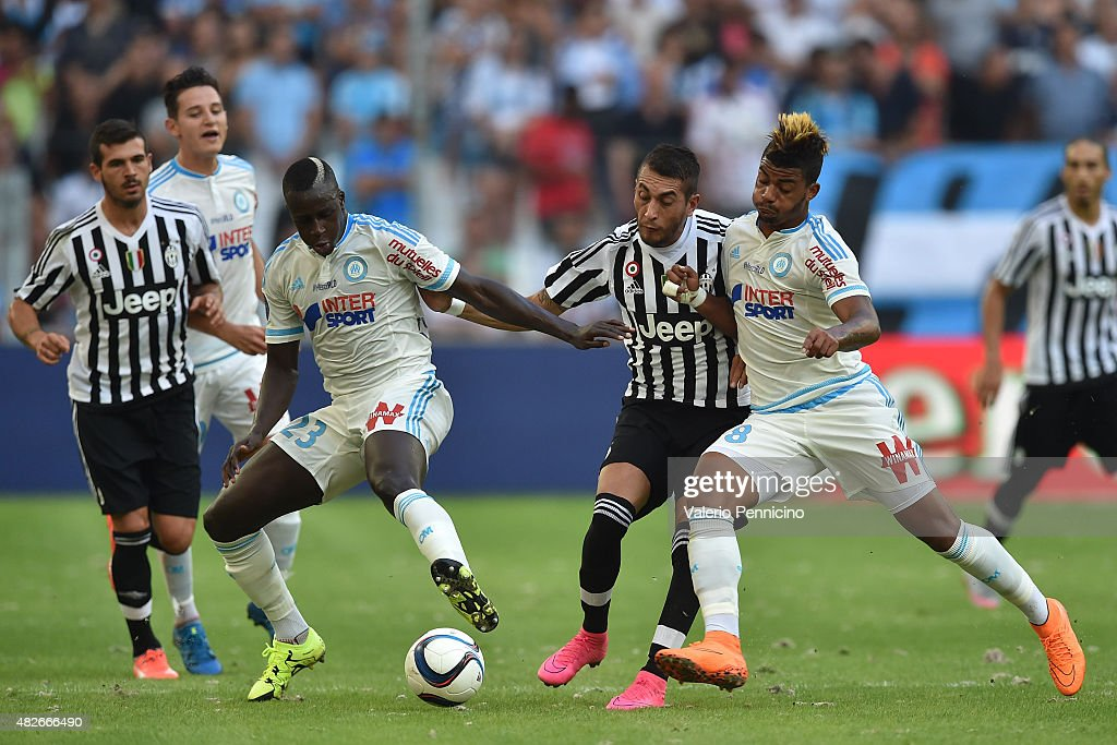 Roberto Maximiliano Pereyra (C) of Juventus FC is challenged by Mario Lemina (R) and <a gi-track='captionPersonalityLinkClicked' href=/galleries/search?phrase=Benjamin+Mendy&family=editorial&specificpeople=7029850 ng-click='$event.stopPropagation()'>Benjamin Mendy</a> of Olympique de Marseille during the preseason friendly match between Olympique de Marseille and Juventus FC at Stade Velodrome on August 1, 2015 in Marseille, France.