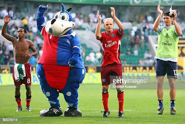 Roberto of Hamburg mascot Dino David jarolim and Wolfgang Hesl celebrate the 42 victory after the Bundesliga match between VfL Wolfsburg and...
