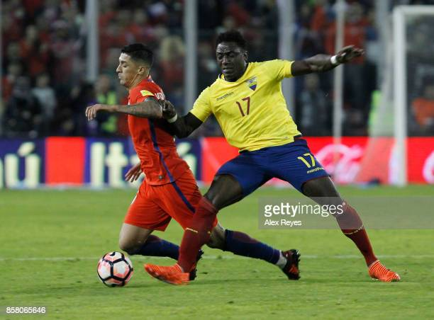 Roberto Ordoñez of Ecuador fights for the ball with Pedro Pablo Hernandez of Chile during a match between Chile and Ecuador as part of FIFA 2018...