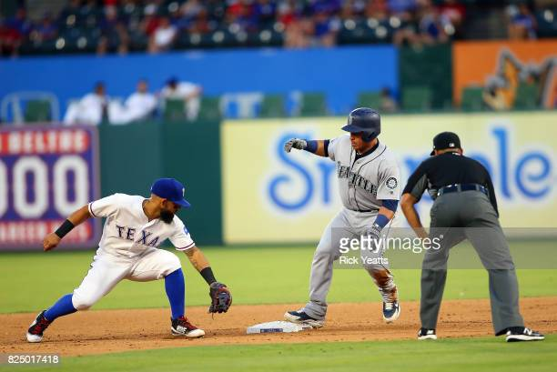 Roberto Ortiz umpire looks on as as Rougned Odor of the Texas Rangers misses the tag on Carlos Ruiz of the Seattle Mariners in the fourth inning at...